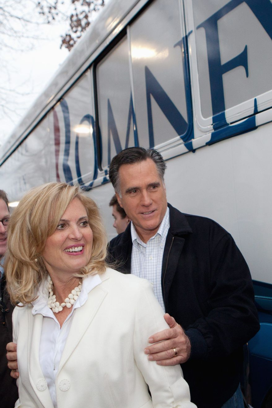 "Former Massachusetts Gov. Mitt Romney, a Republican presidential candidate, greets supporters as he arrives at a campaign stop at the Stage Restaurant in Keene, N.H., on Wednesday. Mr. Romney is kicking off a three-day ""Earn It"" bus tour of the state. (Associated Press)"