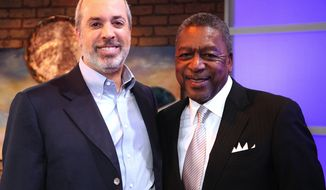 "Financial whiz Ric Edelman and BET founder and business man Robert Johnson talk up ""business solutions to social problems."" (image from 3 Roads Communications)"