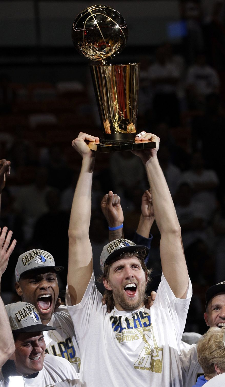 In this June 12, 2011 file photo, Dallas Mavericks' Dirk Nowitzki holds up the championship trophy after Game 6 of the NBA Finals basketball game against the Miami Heat in Miami. The Mavericks won 105-95 to win the series. (AP Photo/David J. Phillip, File)