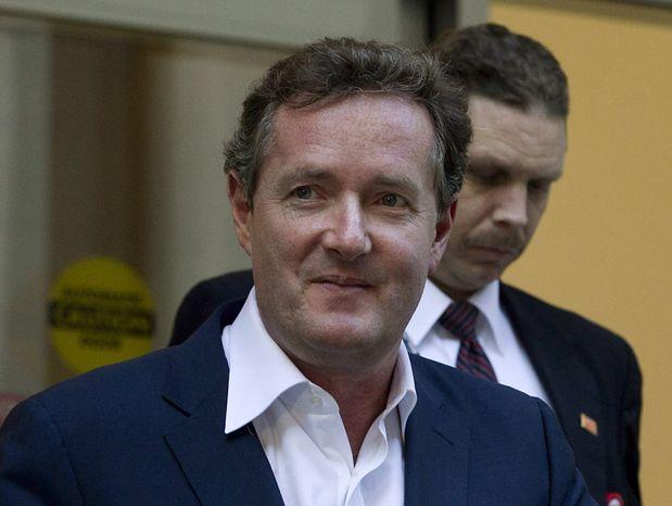 "**FILE** Piers Morgan, host of CNN's ""Piers Morgan Tonight,"" leaves the CNN building in Los Angeles on Dec. 20, 2011. (Associated Press)"