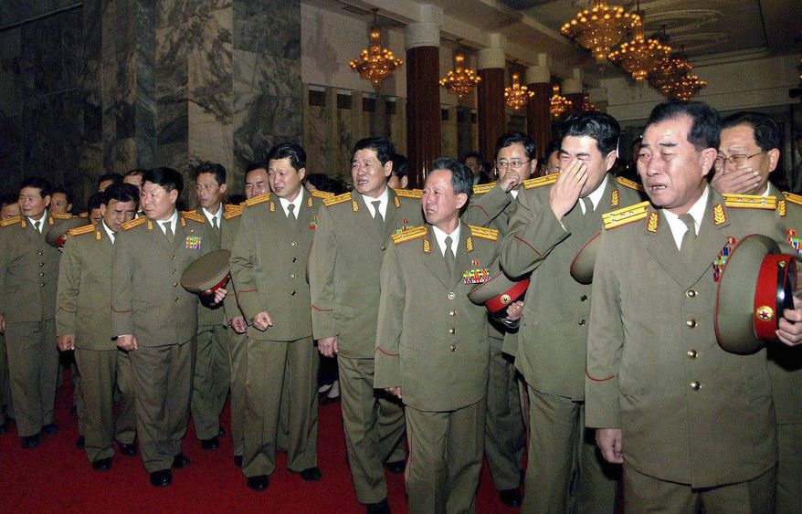 North Korean military personnel cry as they visit the Kumsusan Memorial Palace to pay their respects to leader Kim Jong-il in Pyongyang, North Korea, on Tuesday, Dec. 20, 2011. (AP Photo/Korean Central News Agency via Korea News Service)