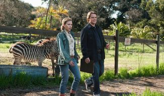 "Matt Damon plays a widowed man who moves with his children to the country where he takes over a zoo and meets a zookeeper played by Scarlett Johansson in ""We Bought a Zoo."" (20th Century Fox via Associated Press)"