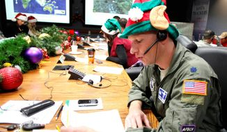 Air Force Lt. Col. David Hanson, of Chicago, takes a phone call from a child in Florida at the Santa Tracking Operations Center at Peterson Air Force Base near Colorado Springs on Christmas Eve 2010. The tradition began in 1955, as a result of a newspaper typographical error. (Associated Press)