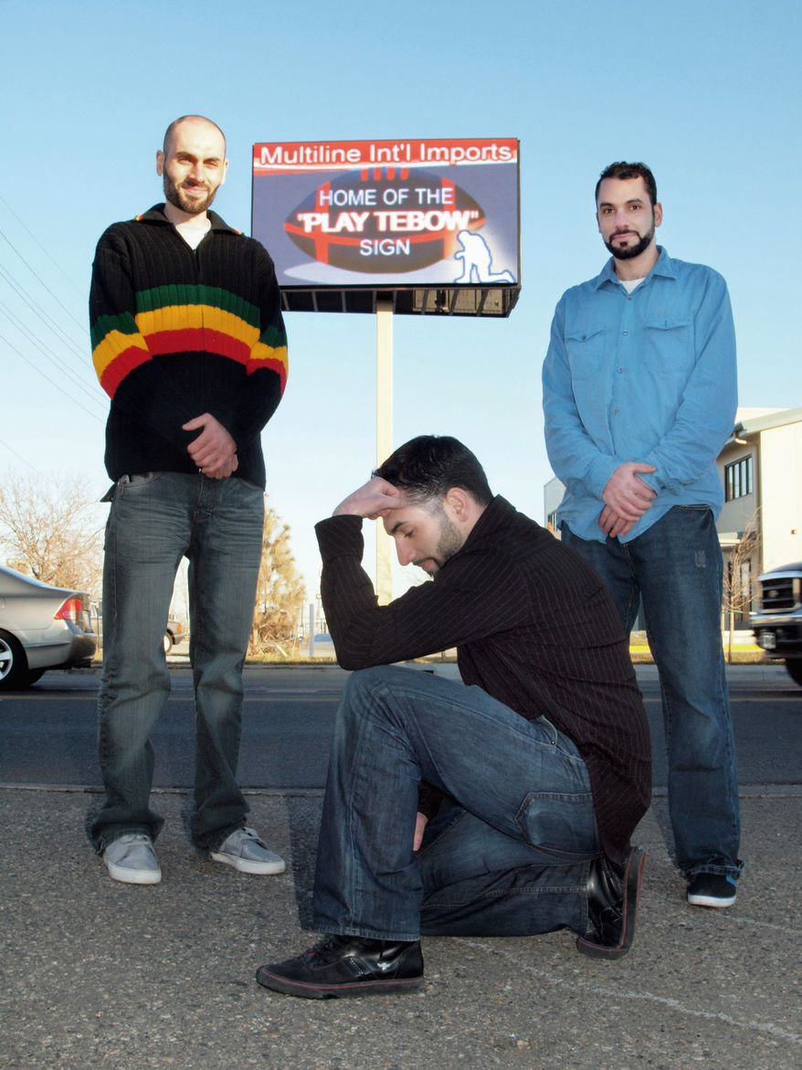 BRONCO BROTHERS: Mohammad Suleiman (center) imitates his NFL hero, Tim Tebow, as brothers Ali (left) and Tariq look on. (Stan Lukowicz/The Washington Times)