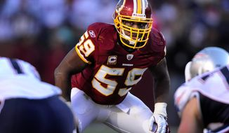 Redskins middle linebacker London Fletcher re-signed with Washington on Thursday. He led the NFL with 166 tackles in the 2011 season and has played in 224 consecutive games. (Preston Keres/Special to The Washington Times)