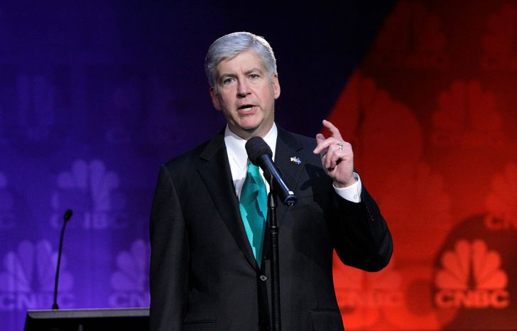 """""""I am gratified that the Legislature removed the definition of public employer from the bill, which included institutions of higher education, in favor of a definition of public employees that makes no specific reference to university employees,"""" said Gov. Rick Snyder, Michigan Republican. (Associated Press)"""