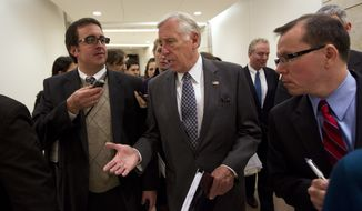 House Minority Whip Rep. Steny Hoyer, Maryland Democrat, is followed by reporters after holding a news conference on the payroll tax cut on Capitol Hill on Thursday, Dec. 22, 2011 in Washington. (AP Photo/Evan Vucci)