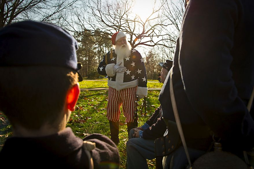 """Santa makes his rounds and meets with Union soldiers with Brady's Michigan Sharpshooters during the Civil War-era Christmas event called """"Christmas in Camp"""" at Fort Ward in Alexandria on Saturday, Dec. 10, 2011. This holiday event, which explores how Christmas was observed during the Civil War, features living-history interpreters, a Victorian Christmas tree, period music and a Santa Claus from the 1860s. (Rod Lamkey Jr./The Washington Times)"""