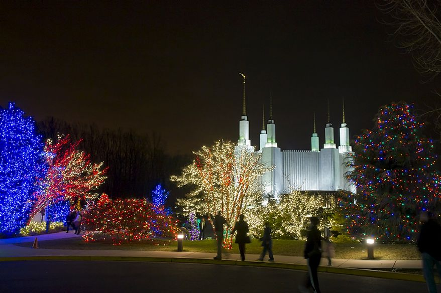 "The Church of Jesus Christ of Latter-day Saints' Washington Temple in Kensington glows against the night sky on Wednesday, Dec. 14, 2011, during the church's 34th annual ""Festival of Lights."" Some highlights of this year's festivities include more than 500,000 lights, nightly musical performances, 16 decorated Christmas trees and a life-sized outdoor Nativity scene. (Rod Lamkey Jr./The Washington Times)"