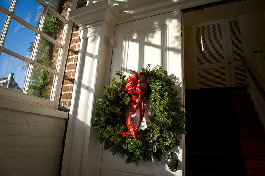 A wreath hangs on the door of Christ Church in Alexandria on Sunday, Dec. 18, 2011. (Rod Lamkey Jr./The Washington Times)