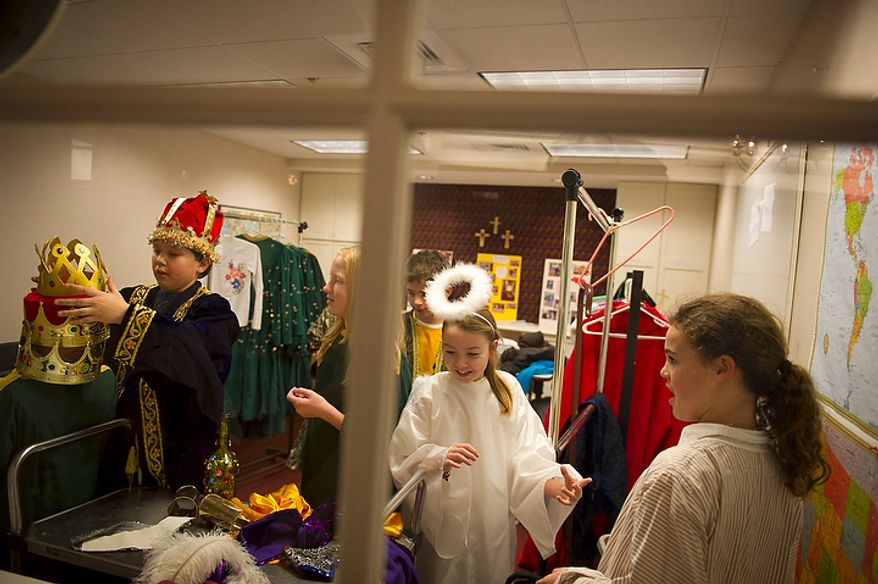 Children get into their costumes as they prepare for their performances in the Nativity section of the Christmas pageant at Christ Church in Alexandria on Sunday, Dec. 18, 2011. (Rod Lamkey Jr./The Washington Times)