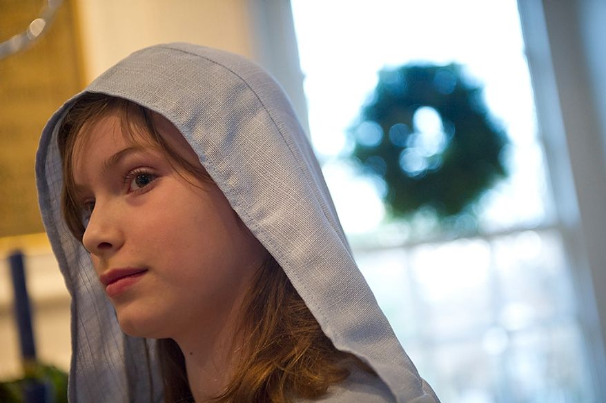 At Christ Church in Alexandra, where President George Washington worshipped, Lindy, 10, plays the role of Mary during a rehearsal for the Nativity scene in the church's Christmas pageant on Sunday, Dec. 18, 2011. (Rod Lamkey Jr./The Washington Times)