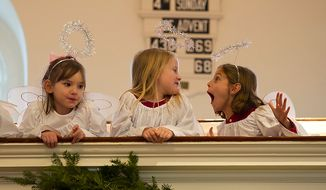 Girls portraying angels play on the balcony during a rehearsal of the Nativity scene of the Christ Church Christmas pageant in Alexandria on Sunday, Dec. 18, 2011. (Rod Lamkey Jr./The Washington Times)