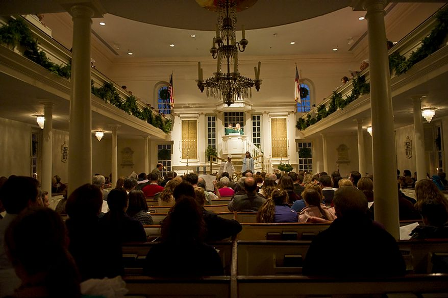 The pews are filled during the performance of the Nativity scene during the Christ Church Christmas pageant in Alexandria on Sunday, Dec. 18, 2011. (Rod Lamkey Jr./The Washington Times)