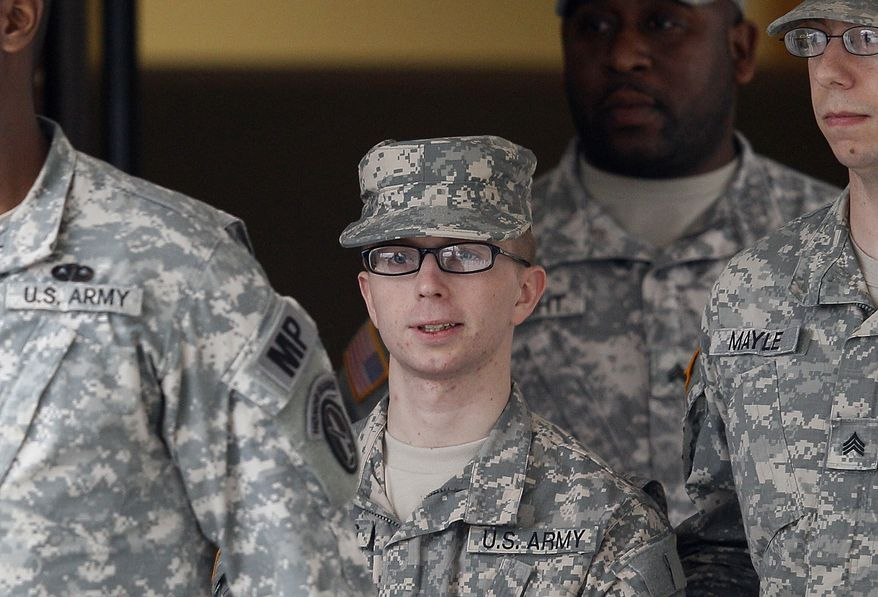 ** FILE ** Army Pfc. Bradley Manning (center) is escorted from a courthouse at Fort Meade, Md., on Wednesday, Dec. 21, 2011, after a military hearing to determine if he should face a court-martial for allegedly leaking classified material to WikiLeaks. (AP Photo/Patrick Semansky)
