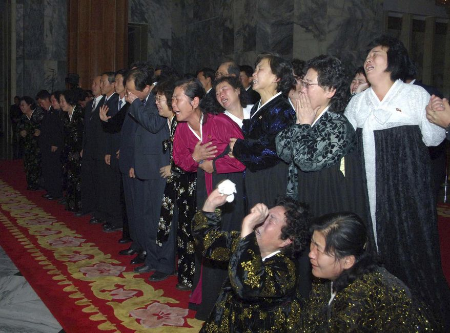 North Koreans cry as they pay their respects to Kim Jong-il, their late leader, at Kumsusan Memorial Palace in Pyongyang, North Korea, on Tuesday, Dec. 20, 2011. (AP Photo/Korean Central News Agency via Korea News Service)