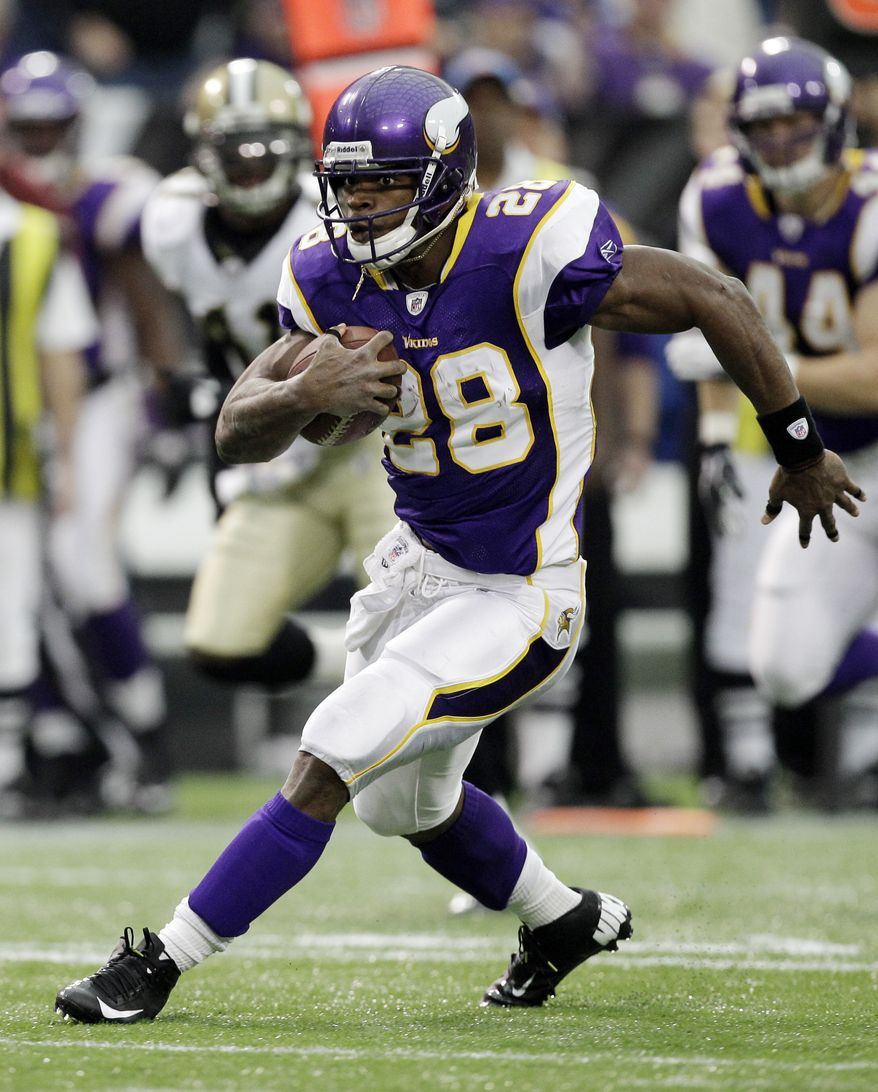 Minnesota Vikings' Adrian Peterson breaks away for a 39-yard run during the first half against the New Orleans Saints Sunday, Dec. 18, 2011, in Minneapolis. (AP Photo/Charlie Neibergall)