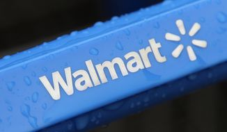** FILE ** Droplets of rain cover the handle of a shopping cart outside a Wal-Mart store. (AP Photo/Amy Sancetta)