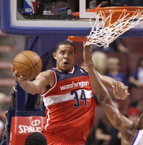 Washington Wizards' JaVale McGee goes for a score against the Philadelphia 76ers in the second half of a preseason game Tuesday, Dec. 20, 2011, in Philadelphia. The 76ers won 101-94. (AP Photo/H. Rumph Jr )