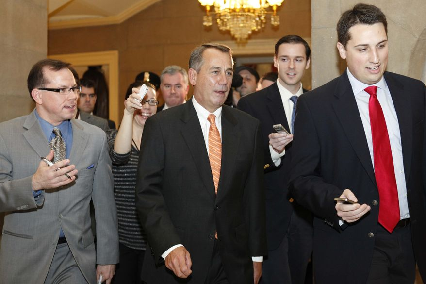 ** FILE ** Speaker of the House John Boehner of Ohio, center, is surrounded by reporters after exiting a House vote on the payroll tax cut in Washington, on Friday, Dec. 23, 2011. (AP Photo/Jacquelyn Martin)