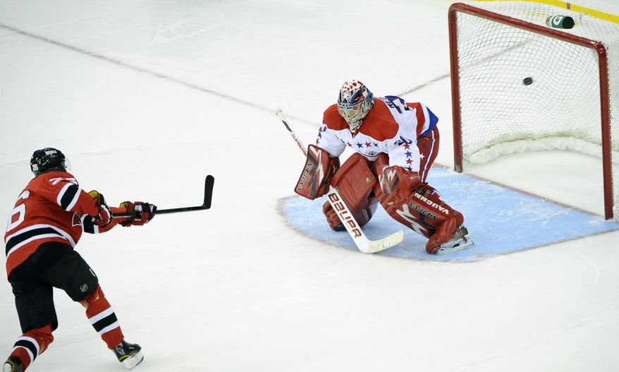 Washington Capitals goaltender Michal Neuvirth was beaten in the shootout by Patrik Elias (shown) and Ilya Kovalchuk, but he made 25 saves during the game's 65 minutes. The Devils ultimately won 4-3 in a shootout. (AP Photo/Bill Kostroun)