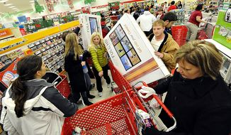 ** FILE ** In this Nov. 25, 2011, file photo, shoppers scramble for door buster deals at Target, in Bowling Green, Ky. U.S. consumers spent at a lackluster rate in November as their incomes barely grew, suggesting that U.S. households may struggle to sustain their spending into 2012. (AP Photo/Daily News, Joe Imel, File)