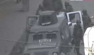 This image made from amateur video and made available by Ugarit News Group Thursday, Dec. 22, 2011, purports to show an armored vehicle in Damascus, Syria. The Associated Press cannot independently verify the content, date, location or authenticity of this material. (AP Photo/Ugarit News Group via APTN)