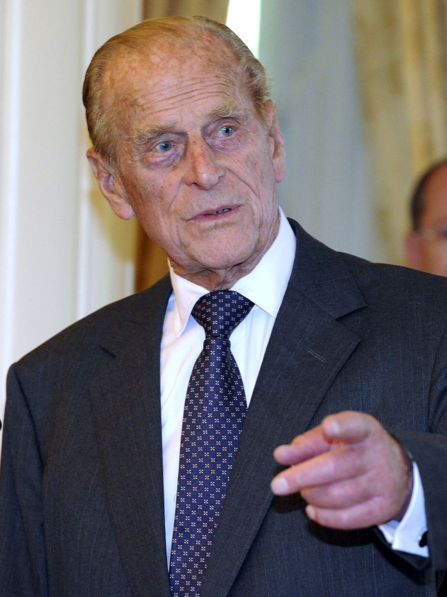 ** FILE ** Britain's Prince Philip arrives at Government House in Canberra, Australia, in this Friday, Oct. 21, 2011, file photo. Queen Elizabeth II's husband has been taken to the hospital after experiencing chest pains, British royal officials said Friday Dec 23, 2011. (AP Photo/Torsten Blackwood, Pool, file)