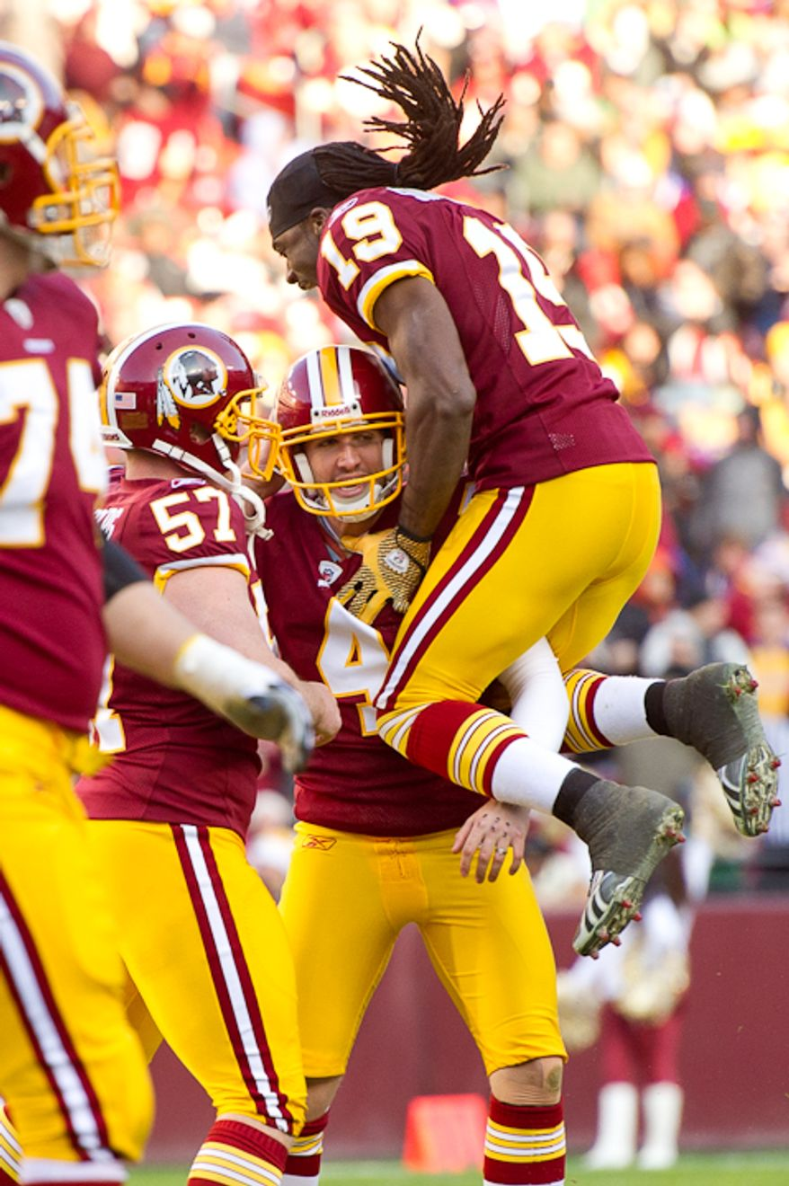 Washington Redskins kicker Graham Gano (4) celebrates with Washington Redskins wide receiver Donte' Stallworth (19) and Washington Redskins long snapper Nick Sundberg (57) after kicking a 53 yard field goal to put the Reskins up 13-10 in the third quarter against the Minnesota Vikings at Fedex Field, Landover, Md., Saturday, Dec. 24, 2011. (Andrew Harnik / The Washington Times)
