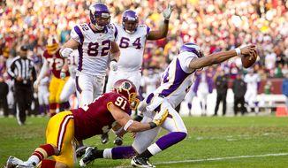 Minnesota Vikings quarterback Joe Webb (14) runs in a 9-yard touchdown to put the Vikings on top in the third quarter as the Washington Redskins take on the Minnesota Vikings at Fedex Field, Landover, Md., Saturday, Dec. 24, 2011. (Andrew Harnik / The Washington Times)