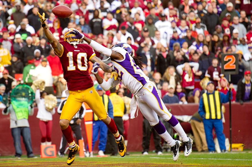 Washington Redskins wide receiver Jabar Gaffney (10) pulls in a 4 yard touchdown over Minnesota Vikings defensive back Benny Sapp (22) to put Washington up 20-17 in the third quarter as the Washington Redskins take on the Minnesota Vikings at Fedex Field, Landover, MD, Saturday, December 24, 2011. (Andrew Harnik / The Washington Times)