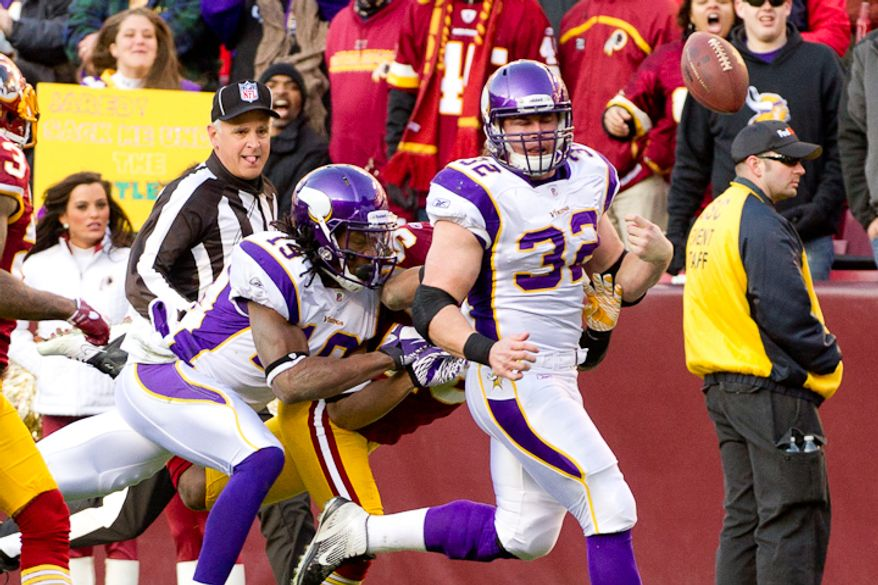 Minnesota Vikings running back Toby Gerhart (32) has the ball punched out as he runs for a 67 yard gain in the third quarter as the Washington Redskins take on the Minnesota Vikings at Fedex Field, Landover, MD, Saturday, December 24, 2011. The ball went out of bounds and Minnesota remained in possession. (Andrew Harnik / The Washington Times)