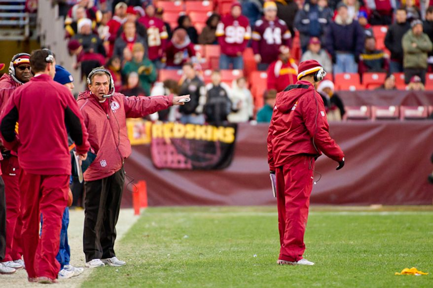 Washington Redskins head coach Mike Shanahan shows his frustration on the sideline after a penalty sets back the Redskins chance for a late drive late in the fourth quarter as the Washington Redskins lose to the Minnesota Vikings 33-26 at Fedex Field, Landover, MD, Saturday, December 24, 2011. (Andrew Harnik / The Washington Times)