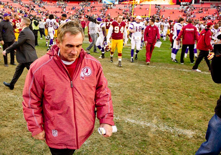 Washington Redskins head coach Mike Shanahan leaves the field as the Washington Redskins lose to the Minnesota Vikings 33-26 at Fedex Field, Landover, MD, Saturday, December 24, 2011. (Andrew Harnik / The Washington Times)