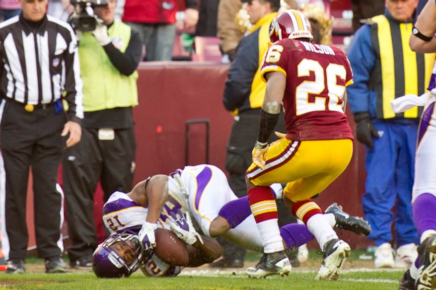 Minnesota Vikings wide receiver Percy Harvin (12) catches an 8 yard touchdown pass to put Minnesota up 30-23 in the fourth quarter as the Washington Redskins take on the Minnesota Vikings at Fedex Field, Landover, MD, Saturday, December 24, 2011. (Andrew Harnik / The Washington Times)