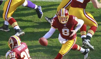 Washington Redskins quarterback Rex Grossman (8) runs play action with starting running back Evan Royster (35) on Saturday, Dec. 24, 2011, against the Minnesota Vikings. Royster had 132 yards on 19 carries. (AP Photo/Haraz N. Ghanbari)