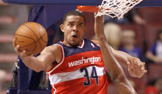 Washington Wizards owner Ted Leonsis has a rebuilding plan that includes center JaVale McGee, who flashed his ability to dazzle in a preseason loss to Philadelphia. Perfecting a sky hook would make McGee a nice fit in Washington's lineup. (Associated Press)