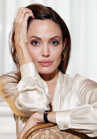 """""""I've always tried to step outside my comfort zone. Sometimes that can be good and useful for hopeful things like this,"""" said actress Angelina Jolie, who has written and directed her first film. (Associated Press)"""
