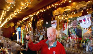 """Pat Troy, owner of Ireland's Own restaurant and pub, remembers that President Reagan had corned beef and cabbage along with a beer when he visited the pub in 1988. Mr. Troy's book, """"I Have a Story to Tell,"""" is the product of decades of experiences as an Irish immigrant and businessman. (Rod Lamkey Jr./The Washington Times)"""