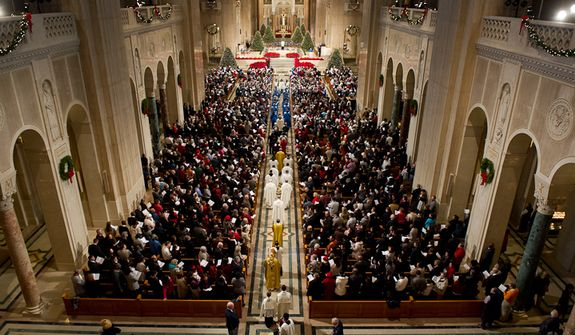 Archbishop of Washington Cardinal Donald Wuerl makes his way down the center isle at the beginning of Christmas Mass held at the Basilica of the National Shrine of the Immaculate Conception on Christmas Day, Washington, D.C., Sunday, Dec. 25, 2011. (Andrew Harnik/The Washington Times)