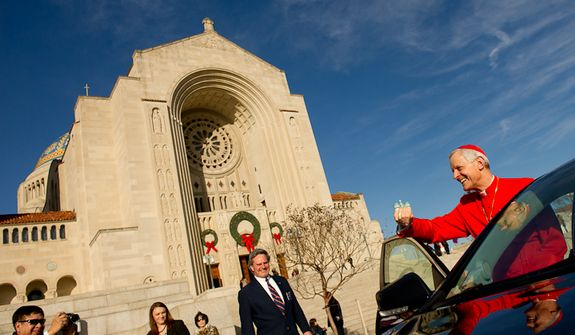 Archbishop of Washington Cardinal Donald Wuerl greets worshippers as he departs after celebrating Christmas Mass at the Basilica of the National Shrine of the Immaculate Conception, Washington, D.C., Sunday, Dec. 25, 2011. (Andrew Harnik/The Washington Times)