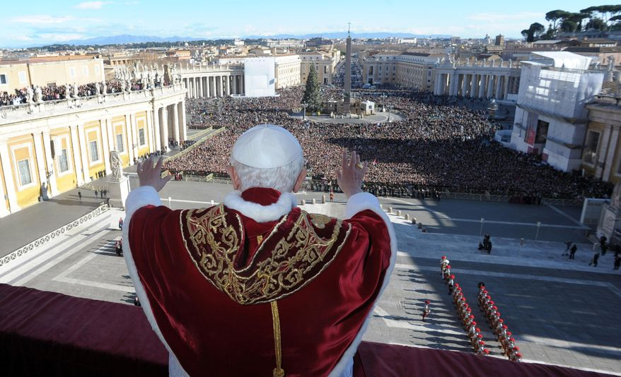 "Pope Benedict XVI delivers his ""Urbi et Orbi"" (Latin for ""To the City and to the World"") speech from the central loggia of St. Peter's Basilica at the Vatican on Sunday, Dec. 25, 2011. (AP Photo/L'Osservatore Romano)"