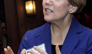 Outside groups on both sides are spending millions of dollars on Massachusetts' high-profile U.S. Senate race between Republican Sen. Scott P. Brown and Democratic challenger Elizabeth Warren (seen here). The level of spending foreshadows the role such groups will play in many of next fall's big political matchups. (Associated Press)