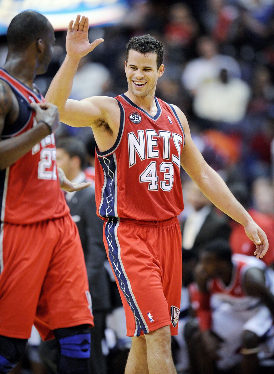 New Jersey forward Kris Humphries answered Wizards fans' boos with 21 points and 16 rebounds. (Associated Press)