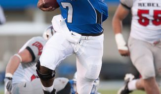 Air Force quarterback Tim Jefferson Jr. rushes against UNLV during the the first quarter of a college football game on Saturday, Nov. 19, 2011, at Air Force Academy, Colo. (AP Photo/The Colorado Springs Gazette, Mark Reis)