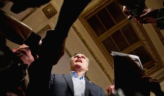 Republican presidential hopeful Mitt Romney greets supporters after delivering a speech kicking off his Iowa bus tour at a hotel in Davenport, Iowa, on Tuesday. The former Massachusetts governor chided President Obama for broken promises. (Andrew Harnik/The Washington Times)