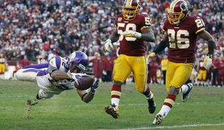 Minnesota Vikings wide receiver Percy Harvin (12) dives for a touchdown as Washington Redskins inside linebacker London Fletcher (59) and cornerback Josh Wilson (26) chase him into the end zone during the second half of an NFL football game against Washington Redskins in Landover, Md., Saturday, Dec. 24, 2011. (AP Photo/Evan Vucci)