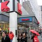 Pedestrians pass a Kmart store on Tuesday, Dec. 27, 2011, in New York. (AP Photo/Frank Franklin II)