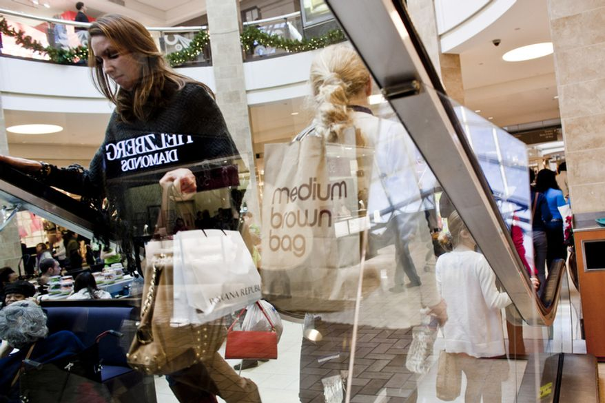 Shoppers crowd the Tysons Corner Center mall in McLean, Va. on Dec. 26, 2011. The National Retail Federation projected this years' holiday sales to be up 3 percent over last year, but the Tysons mall is up 4 percent over last year's sales figures for the Black Friday to Christmas Eve period. 