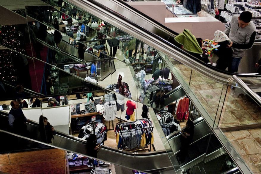 Shoppers file through Macy's at the Tysons Corner Center mall in McLean, Va., for returns and after-Christmas sales on Dec. 26, 2011. (T.J. Kirkpatrick/ The Washington Times)